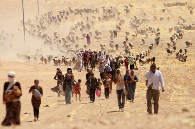 Yezidis escaping ISIS invasion in Shengal 2014