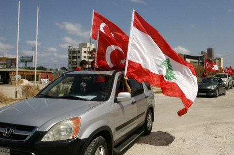 Lebanese supporters and members of the Islamic group Jamaa Islamiya wave Turkish and Lebanese flags during a demonstration to support Turkish President Recep Tayyip Erdogan (portrait) following a deadly but foiled coup attempt by an army faction on July 16, 2016 outside the Islamic Turkish hospital in the southern Lebanese port city of Sidon.